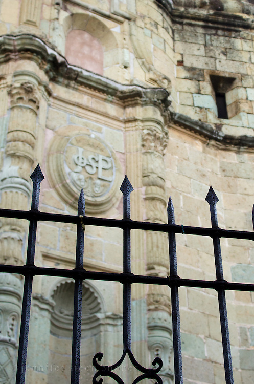 A cast-iron fence surrounds the church of the Compania de Jesus, which stands near the Zocalo of Oaxaca, Mexico.