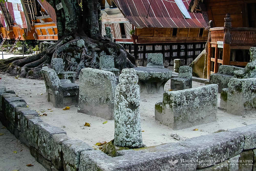Indonesia, Sumatra. Samosir. The famous stone chairs in Ambarita. The prisoner had to sit on the smallest chair while he received his penalty. If he received a death penalty he was led to another group of stones and beheaded.