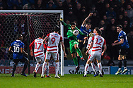 Marko Marosi of Doncaster Rovers (13) is challenged in the air by Peter Clarke of Oldham Athletic (26) during the The FA Cup fourth round match between Doncaster Rovers and Oldham Athletic at the Keepmoat Stadium, Doncaster, England on 26 January 2019.