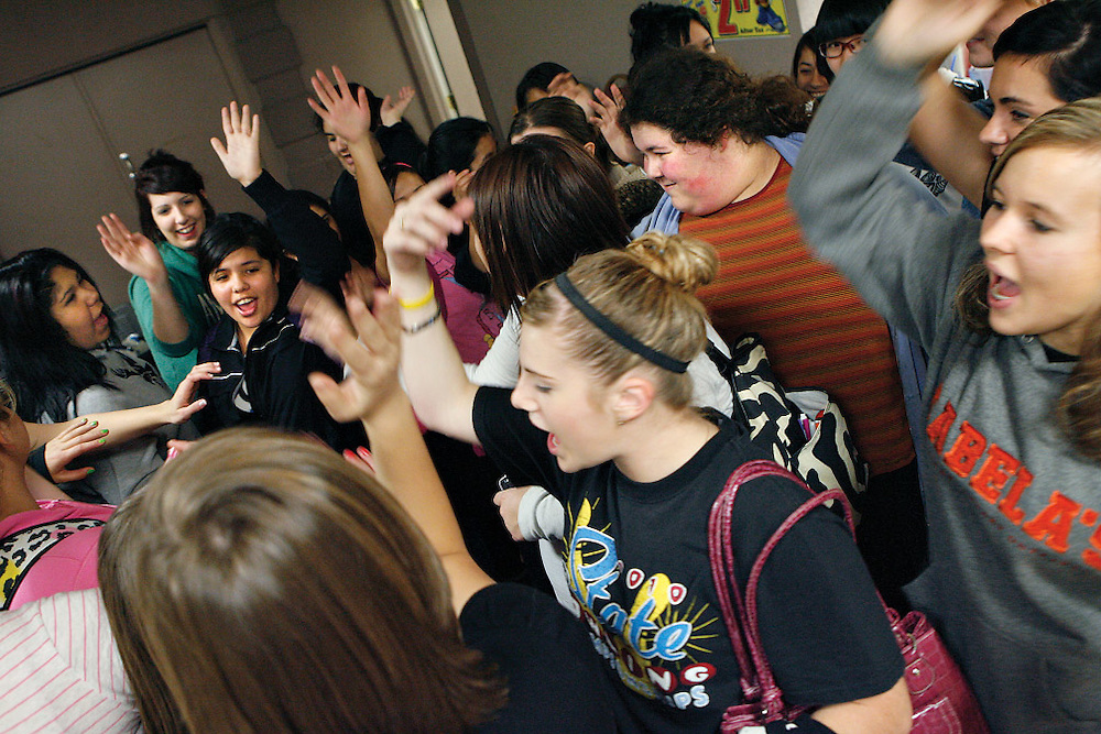 """Veterans teach the new members the team cheer after the first practice of the season. Out of 40 girls who came out for the team, only two quit. """"We have different girls,"""" says head coach Oscar Garnica, """"those who truly want to compete all the way down to those who just want to socialize, which is fine. I personally don't mind opening it up for those girls who just want to come in here and bowl and have fun. It's OK because I'd rather have them here than out in the streets."""" Nobody is cut from the team because of skill, but the top bowlers are competing for the five varsity and two alternate spots."""