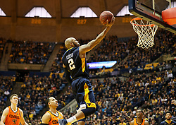 Feb 10, 2018; Morgantown, WV, USA; West Virginia Mountaineers guard Jevon Carter (2) shoots a layup during the second half against the Oklahoma State Cowboys at WVU Coliseum. Mandatory Credit: Ben Queen-USA TODAY Sports