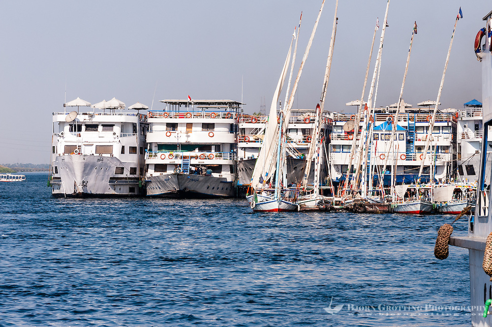 Egypt, Luxor. The Nile passing Luxor. Riverboats and felucca's, a traditional sailboat.