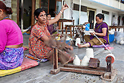 A Nepalese women sit spinning wool to create yarn for R.C Rug Factory in Narayanthan area of Kathmandu, Nepal. The R.C Rug Factory export to Europe, U.S and Canada; and rely on the Good Weave certificate of approval to boast excellent quality and fair conditions for its workers. This is because the carpet factory industry in Nepal is notorious for providing poor working conditions and forcing young children into labour.
