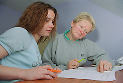 Project manager advising client on completing Supported Housing form,