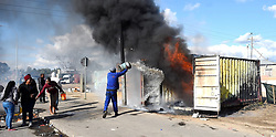 South Africa -Cape Town - 06 August 2020 - Bakcyarders of Bloekombos in Kraaifontein invaded Tygerberg raceway and an open field erecting shacks.They made markings to build shacks but Law Enforcement removed them,that resulted in a violent protest in the area .A congolese shop was torched and some belongings were lost.Picture:Phando Jikelo/African News Agency(ANA)