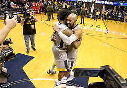 Feb 26, 2018; Morgantown, WV, USA; West Virginia Mountaineers guard Jevon Carter (2) and West Virginia Mountaineers guard Daxter Miles Jr. (4) hug at mid court after beating the Texas Tech Red Raiders at WVU Coliseum. Mandatory Credit: Ben Queen-USA TODAY Sports