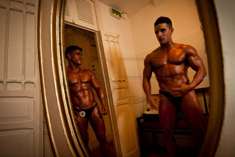 For two years in a row, in a rundown theater in Porto, the Portuguese National Championship of Bodybuilding WABBA happened. Several athletes, from allover the country came to this one day competition. <br />These are photos from the backstage, where the athletes exercise and get body paint for the stage presentation. The muscles and the gold and brown colors get ready in the confusion of tubes, abandoned wood from different theater plays, photos from the past and dressing rooms with 100 years old.
