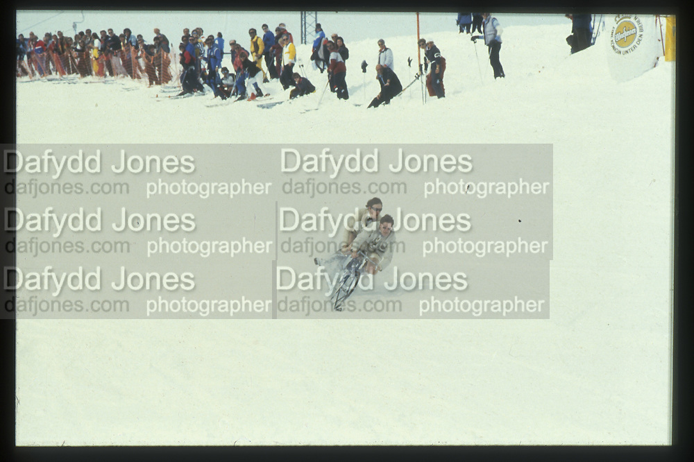 Xan Rufus Isaacs and Tim Hunt, Dangerous Sports Club Ski race. St. Moritz. 1983 approx. © Copyright Photograph by Dafydd Jones 66 Stockwell Park Rd. London SW9 0DA Tel 020 7733 0108 www.dafjones.com