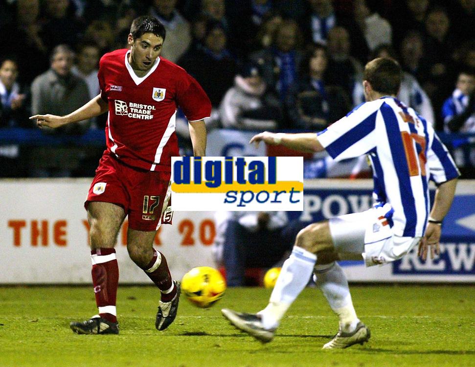 Photo: Chris Ratcliffe.<br />Colchester United v Bristol City. Coca Cola League 1. 17/01/2006.<br />Colchester's John White tries to stop Bristol's Bradley Orr (L).