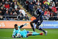 Swansea city keeper Michel Vorm saves from Tottenham's Emmanuel Adebayor.  Barclays Premier League, Swansea city v Tottenham Hotspur at the Liberty Stadium in Swansea, South Wales on Saturday 30th March 2013. pic by Andrew Orchard, Andrew Orchard sports photography,