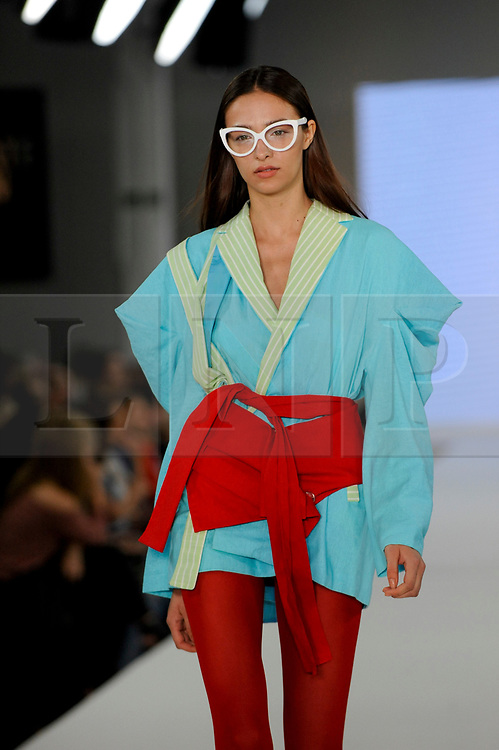 © Licensed to London News Pictures. 05/06/2017. London, UK. A model presents a look by Erika Santiago from The Arts University Bournemouth on the second day of Graduate Fashion Week taking place at the Old Truman Brewery in East London.  The event showcases the graduation show of up and coming fashion designers from UK and international universities. Photo credit : Stephen Chung/LNP