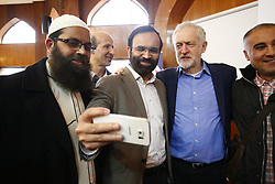 © Licensed to London News Pictures. 05/02/2017. London, UK.  Labour leader JEREMY CORBYN poses for a selfie with members of Finsbury Park Mosque in North London during an open day.  On Visit My Mosque Day over 150 mosques around the UK open their doors to the public, offering a better understanding of religion in effort to counter rising Islamophobia.  Photo credit: Tolga Akmen/LNP