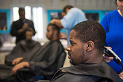 Prisoners have their hair cut in the prison barber shop at HMP/YOI Portland, Dorset. A resettlement prison with a capacity for 530 prisoners. Portland, Dorset, United Kingdom.