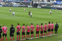 Football - 2020 / 2021 Sky Bet Championship - Swansea City vs Derby County - Liberty Stadium<br /> <br /> Derby County team stands as Swansea 'take the knee' before ko<br /> <br /> COLORSPORT/WINSTON BYNORTH