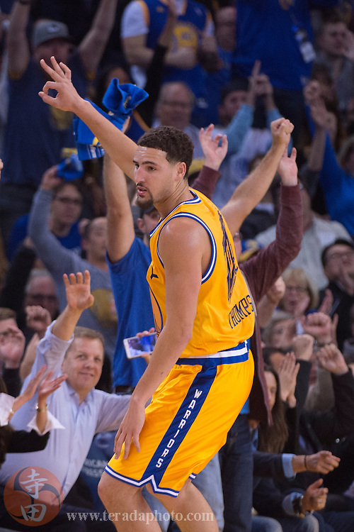 November 17, 2015; Oakland, CA, USA; Golden State Warriors guard Klay Thompson (11) celebrates after making a three-point basket during the second quarter against the Toronto Raptors at Oracle Arena. The Warriors defeated the Raptors 115-110.