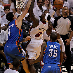 Jun 21, 2012; Miami, FL, USA; Miami Heat small forward LeBron James (6) shoots over Oklahoma City Thunder power forward Nick Collison (4) during the fourth quarter of the 2012 NBA Finals at the American Airlines Arena. Miami won 121-106. Mandatory Credit: Derick E. Hingle-US PRESSWIRE