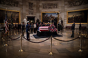 A military honor guard watches over the casket of Former President George H.W. Bush as it lies in state at the U.S. Capitol on Dec. 3, 2018.<br /> <br /> Credit: Cameron Pollack for NPR