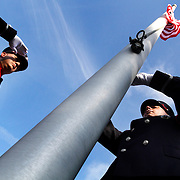 Richard Dollahan, Capt. Bluffton Fire Department, left, salutes the flag as Doug Favors, Lt. Bluffton Fire Department, right, lowers the flag to half-mast during a September 11th anniversary ceremony at the Michael C. Riley Elementary School Flag Court Garden on September 11, 2014.