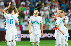 Nejc Pecnik of Slovenia and other players of Slovenia look dejected after the EURO 2016 Qualifier Group E match between Slovenia and England at SRC Stozice on June 14, 2015 in Ljubljana, Slovenia. Photo by Vid Ponikvar / Sportida