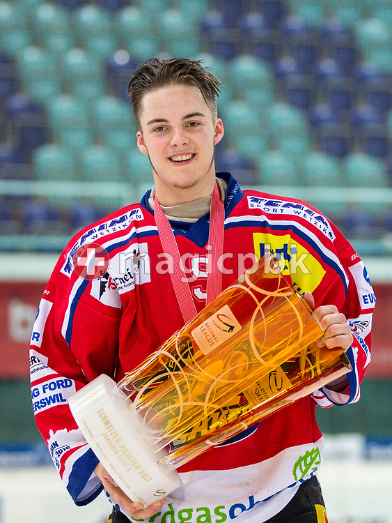 Rapperswil-Jona Lakers defenseman Janis Manser poses for a photo with his gold medal and the Swiss Champion trophy after winning the fifth Elite B Playoff Final ice hockey game between Rapperswil-Jona Lakers and ZSC Lions held at the SGKB Arena in Rapperswil, Switzerland, Sunday, Mar. 19, 2017. (Photo by Patrick B. Kraemer / MAGICPBK)