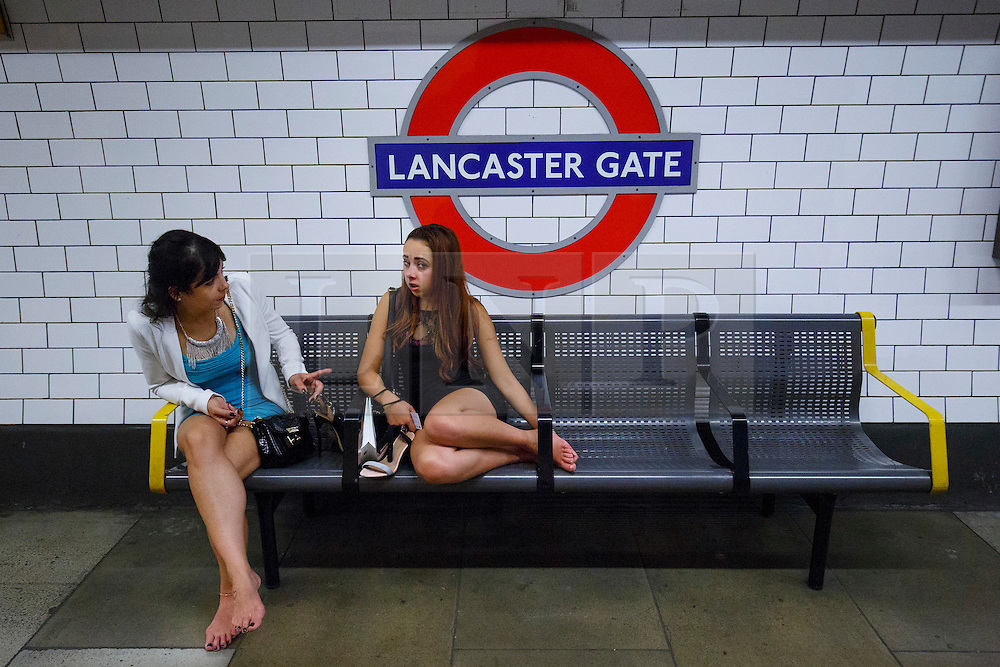 © Licensed to London News Pictures. 20/08/2016. London, UK. Barefooted tube passengers travel on the night tube service of Central line in London for the first time on 20 August 2016. Transport for London started a 24-hour Tube service on Victoria and Central lines as demand has soared over recent years, with passenger numbers on Friday and Saturday nights up by around 70 per cent since 2000. The plan was announced in November 2013 and intended to begin in September 2015, but strikes over pay delayed the start by nearly another year. Photo credit: Tolga Akmen/LNP