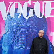 """VENICE, ITALY - JUNE 01:  Cretaor of fashion magazines and artisit Flavio Lucchini poses in front of his work """"poster/vogue"""" part of the exhibition """"What Women Want (?)"""" on June 1, 2011 in Venice, Italy. The exhibition addresses the controversiat theme of the burqa"""