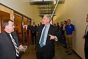U.S. Deputy Energy Secretary Daniel Poneman, center, asks CEO of American Power Electronics International Alex Lostetter, left, a question during a tour of APEI on Wednesday, May 23, 2012, in Fayetteville, Ark. Poneman  announced new steps to support clean energy small businesses including $11 million in innovative research and technology grants and toured Arkansas Power Electronics International, APEI.