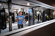 WASHINGTON, DC - NOVEMBER 14: Celena Georgia, 23, of Washington, DC, participates in a boxing conditioning class at NUBOXX on Wednesday, November 14, 2018 in Washington, DC. Once a sweaty, gritty environment of men, the recent trend of fitness boxing is now all about brightly-lit studios and fresh millennial faces working the heavy or speed bag. (Photo by Pete Marovich For The Washington Post)