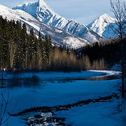 snow blankets mountains in glacier national park