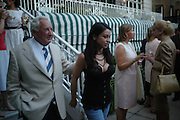 Michael Winner and Paola Pedrini. The Business Summer party hosted by Andrew Neil. Italian Hotel, Ritz Hotel. 12 July 2005. ONE TIME USE ONLY - DO NOT ARCHIVE  © Copyright Photograph by Dafydd Jones 66 Stockwell Park Rd. London SW9 0DA Tel 020 7733 0108 www.dafjones.com