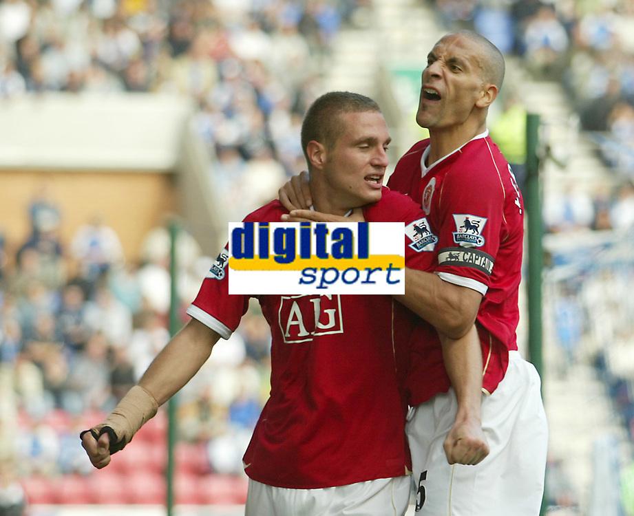 Photo: Aidan Ellis.<br /> Wigan Athletic v Manchester United. The Barclays Premiership. 14/10/2006.<br /> United's Rio Ferdinand celebrtates with first goal scorer Nemanja Vidic