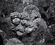 William Rickets Sanctuary - Black and white photo art print of Sculpture of Aboriginal boys in the deep woodland of the Dandenon Mountain near Melbourne Australia. Taken 1993 by Paul Williams,