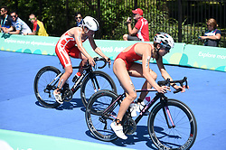 BUENOS AIRES, Oct. 8, 2018  Sif Bendix Madsen of Denmark (L) and Anja Weber of Switzerland compete during the Women's Triathlon match at the 2018 Summer Youth Olympic Games in Buenos Aires, capital of Argentina, Oct. 7, 2018. Sif Bendix Madsen won the silver with 58 minutes 56 seconds and Anja Weber won the bronze with 59 minutes 36 seconds. (Credit Image: © Li Jundong/Xinhua via ZUMA Wire)