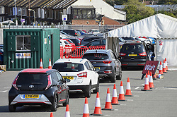 © Licensed to London News Pictures. 16/09/2020. WATFORD, UK.  Drivers in their cars wait to receive a test at the Covid-19 testing centre outside Watford General Hospital in Hertfordshire.  Following the UK government's Operation Moonshot announcement committing to 10 million tests per day, it is reported that the increased demand for Covid-19 tests has led to local shortages of testing slots.  Photo credit: Stephen Chung/LNP