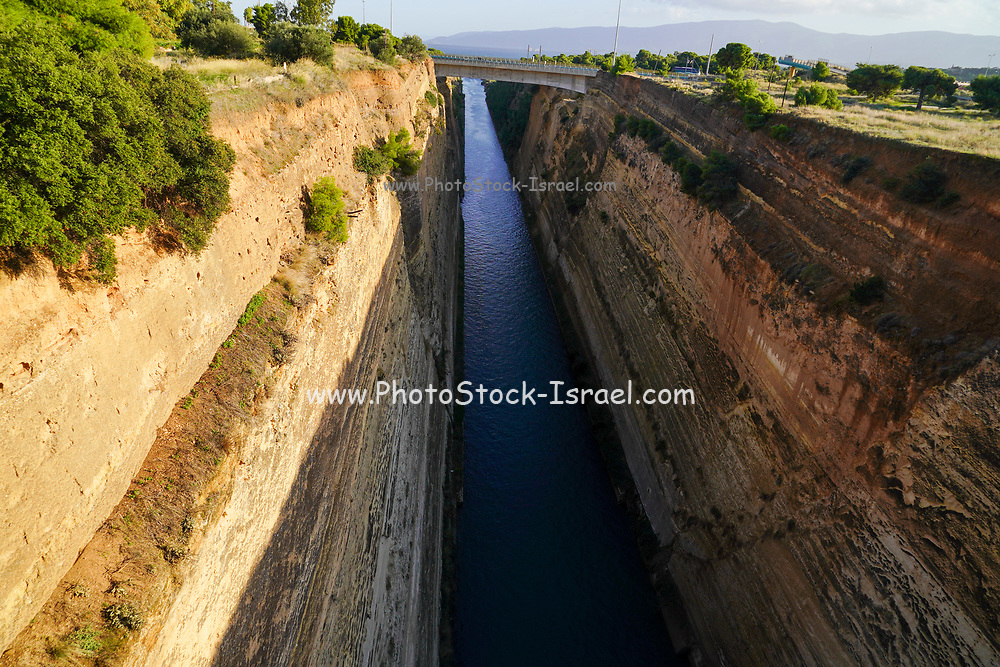 The Corinth Canal connects the Gulf of Corinth in the Ionian Sea with the Saronic Gulf in the Aegean Sea. It cuts through the narrow Isthmus of Corinth and separates the Peloponnese from the Greek mainland, arguably making the peninsula an island. The canal was dug through the isthmus at sea level and has no locks. It is 6.4 kilometres (4 mi) in length and only 21.4 metres (70 ft) wide at its base, making it impassable for many modern ships. It has little economic importance and is mainly a tourist attraction.