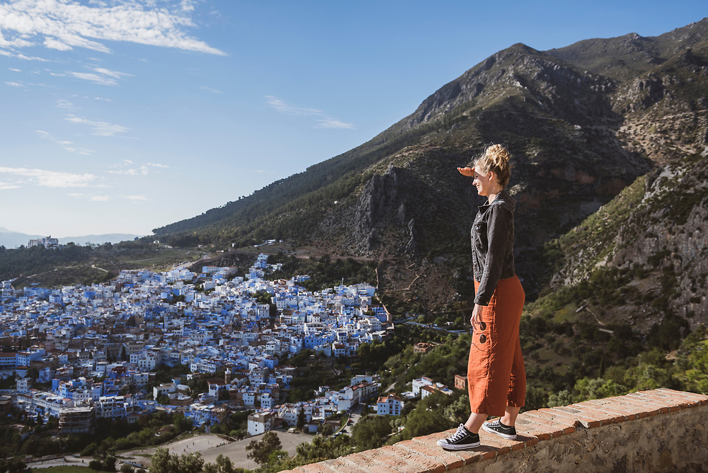Chefchaouen, Morocco - May 10, 2018: Lily Ryan, a 22-year-old traveler from Australia, takes in the view of Chefchaouen from outside the Spanish Mosque.