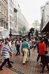 Crowds of people in city centre,
