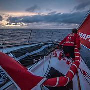 Leg 02, Lisbon to Cape Town, day 08, on board MAPFRE, Sophie Ciszek durante un cambio de vela en el amanecer. Photo by Ugo Fonolla/Volvo Ocean Race. 12 November, 2017