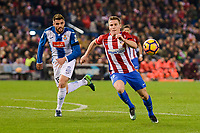 Atletico de Madrid's player Kevin Gameiro and RCD Espanyol player David Lopez during match of La Liga between Atletico de Madrid and RCD Espanyol at Vicente Calderon Stadium in Madrid, Spain. December 03, 2016. (ALTERPHOTOS/BorjaB.Hojas)