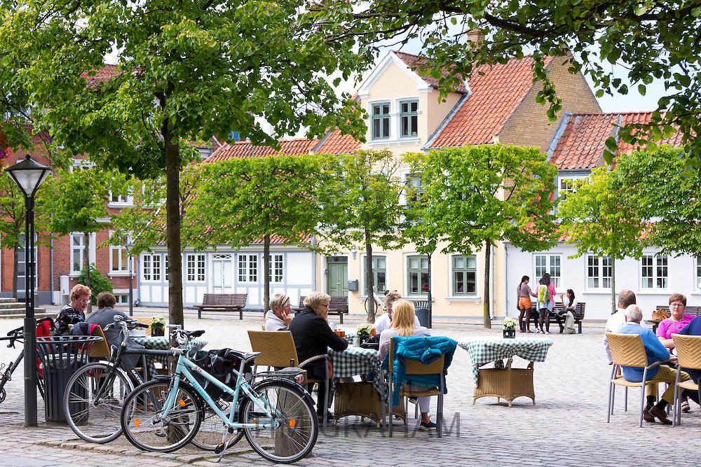 Al fresco dining at street cafe restaurant in Gront Torvet square in old town Odense on Funen Island, Denmark