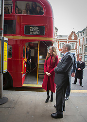 © Licensed to London News Pictures. 07/11/2013.  The The Duchess of Cambridge hops of the Royal British Legions Poppy bus today on Kensington High Street as the charity aimed to collect a million pounds in one day.  The Royal couple met with former and serving soldiers at Kensington Palace and also on High Street Kensington.      Photo credit: Alison Baskerville/LNP