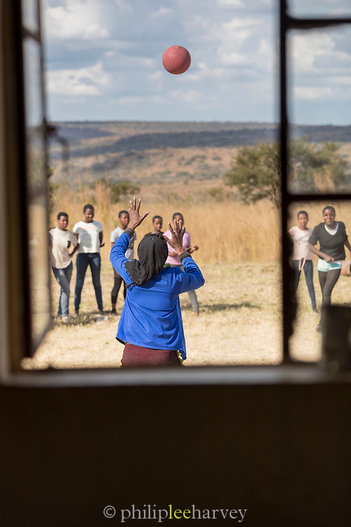 View of girls playing at local village school with ball on schoolyard in Lubombo Region, Eswatini