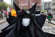 The 'Oil Slick' or 'Black Rebels' activists perform their slow, dark movements at the Extinction Rebellion 'Shell Out' protest on 8th September 2020 in London, United Kingdom. The environmental group gathered outside the Shell building to protest at the ongoing extraction of fossil fuels and the resulting environmental record. Extinction Rebellion is a climate change group started in 2018 and has gained a huge following of people committed to peaceful protests. These protests are highlighting that the government is not doing enough to avoid catastrophic climate change and to demand the government take radical action to save the planet.