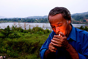Serra Pelada,  November, 08 _ 2006....Pedro Paulo, ex investor and gold digger, smokes a cigarette in front of the Rich Cave lake. He lives in the last 26 years in the Serra Pelada, alone, and not returns home. ....Picture: Bruno Magalhaes / Agencia Nitro