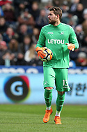 Kristoffer Nordfeldt, the Swansea city goalkeeper in action.The Emirates FA Cup, quarter-final match, Swansea city v Tottenham Hotspur at the Liberty Stadium in Swansea, South Wales on Saturday 17th March 2018.<br /> pic by  Andrew Orchard, Andrew Orchard sports photography.