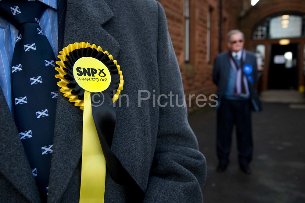 General election 2015. West Kilbride, Scotland. Observers at polling place from SNP, and Conservative parties