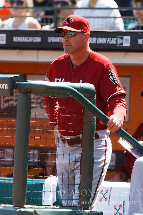 September 4, 2011; San Francisco, CA, USA;  Arizona Diamondbacks manager Kirk Gibson (23) stands in the dugout during the third inning against the San Francisco Giants at AT&T Park. Arizona defeated San Francisco 4-1.