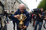 England rugby legend Lawrence Dallaglio carefully takes out the Webb Ellis Trophy from the Land Rover Defender vehicle.  RWC 2015, Coca Cola London Eye launch for the Rugby World cup event  in London on Tuesday 15th Sept  2015.<br /> pic by John Patrick Fletcher, Andrew Orchard sports photography.