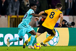 Christian Atsu of Newcastle United takes on Ruben Neves of Wolverhampton Wanderers - Mandatory by-line: Robbie Stephenson/JMP - 11/02/2019 - FOOTBALL - Molineux - Wolverhampton, England - Wolverhampton Wanderers v Newcastle United - Premier League