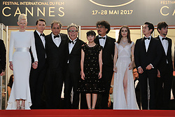 Actors Byung Heebong, Steven Yeun, Giancarlo Esposito, Tilda Swinton, Ahn Seo-Hyun, director Bong Joon-Ho, actors Paul Dano, Lily Collins, Jake Gyllenhaal and Devon Bostic coming out from the Okja Screening as part of the 70th Cannes Film Festival in Cannes, France on May 19, 2017. Photo by Aurore Marechal/ABACAPRESS.COM